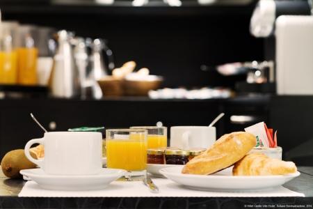 Salle de petit-déjeuner - Hôtel Centre-Ville Etoile
