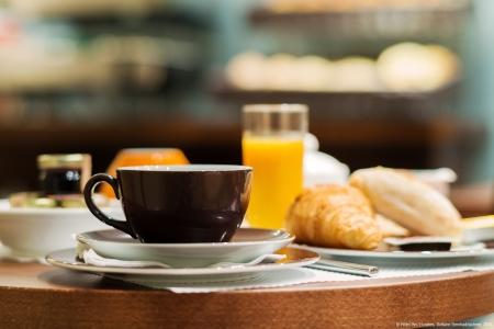 Salle de petit-déjeuner - Hôtel Arc Elysées